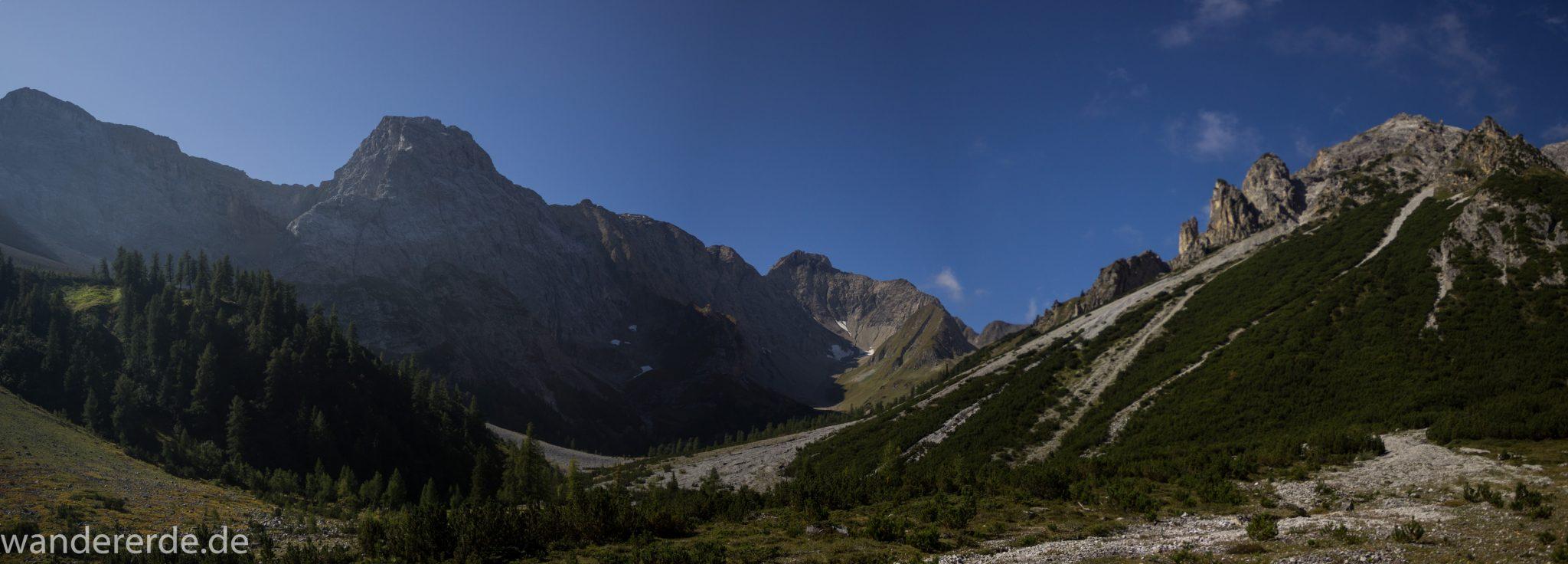 Alpenüberquerung Fernwanderweg E5 Oberstdorf Meran, 3. Etappe von Memminger Hütte zur Skihütte Zams, nach Erreichen der Seescharte folgt ein sehr langer Abstieg ins Lochbachtal auf schmalem Wanderpfad Richtung Zams, Aussicht auf beeindruckende Berge der Alpen und Bergwiesen, grüne Vegetation ist wieder erreicht